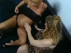 Pregnant lesbians caress each other